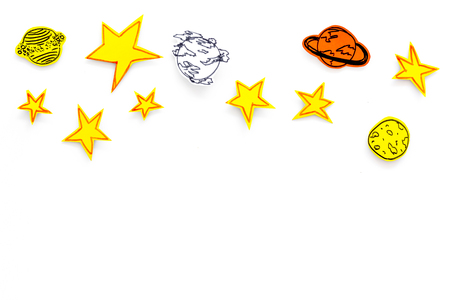 Space concept. Drawn stars, planets, asteroids on white outer space background top view copy space