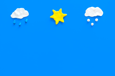 Clear, rainy, snow weather icons on blue background top view copy space