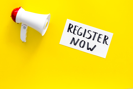 Register now hand lettering icon near megaphone on yellow background top view.