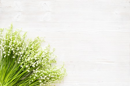 Small and fragrant spring flowers. Bouquet of lily of the valley flowers on white background top view copy space