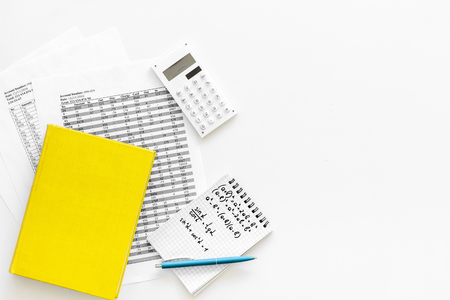 Math homework. Math textbook or tutorial near sheet with numbers, counts, calculator, notebook with formula on white background top view copy space