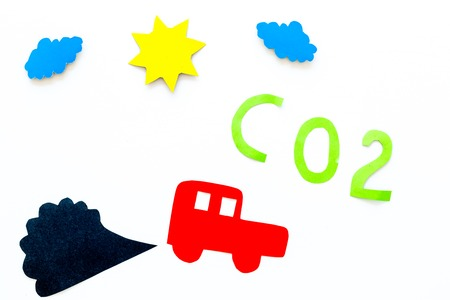 Cars emitting carbon dioxide. Pollution conept. harm the environment. Car and smoke cutout on white background top view copy space