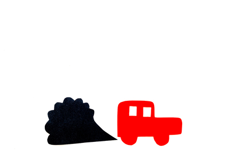 Car emitting dirty smoke. Pollution conept. Car and smoke cutout on white background top view copy space