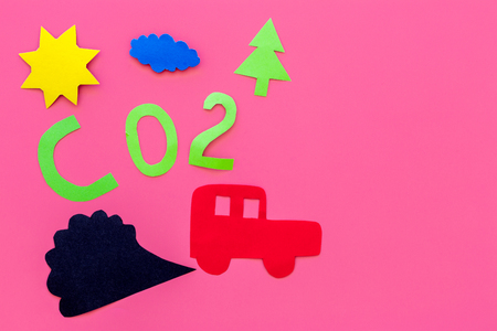 Cars emitting carbon dioxide. Pollution conept. harm the environment. Car and smoke cutout on pink background top view copy space
