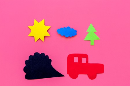 Cars emitting smoke. Pollution conept. harm the environment. Car and smoke cutout on pink background top view copy space