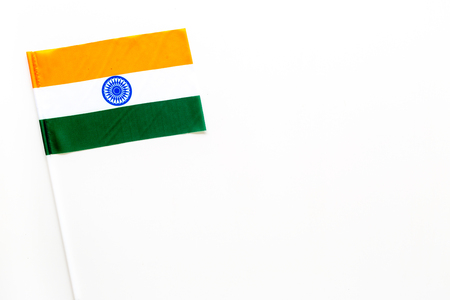 Indian flag concept. small flag on white background top view copy space