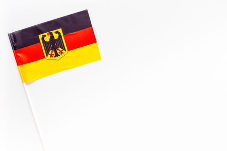 German flag concept. small flag on white background top view copy space