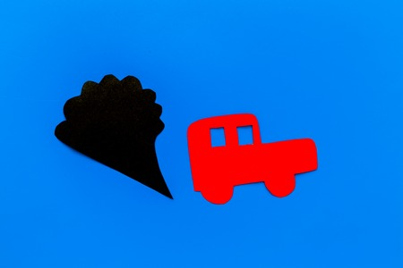 Car emitting dirty smoke. Pollution concept. Car and smoke cutout on blue background top view. Stock fotó
