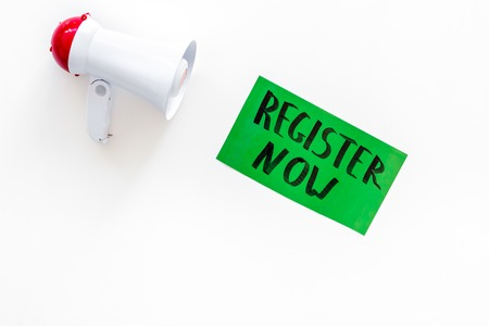 Register now hand lettering icon near megaphone on white background top view copy space