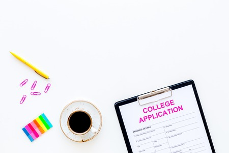 Apply college. Empty college application form near coffee cup and stationery on white background top view. Фото со стока