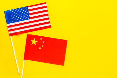 American and Chinese flags top view copy space