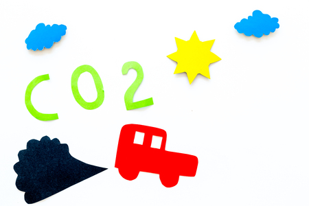 Cars emitting carbon dioxide. Pollution concept. harm the environment. Car and smoke cutout on white background top view copy space