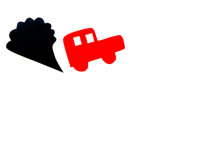 Car emitting dirty smoke. Pollution concept. Car and smoke cutout on white background top view copy space