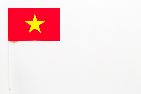 Vietnamese flag concept. Small flag on white background top view copy space