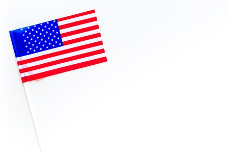 American flag concept. Small flag on white background top view copy space Фото со стока