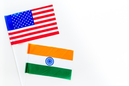 USA-India relations. Country cooperation. American and Indian flags on white background top view copy space