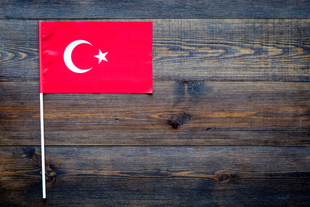 Turkish flag concept. small flag on dark wooden background top view copy space