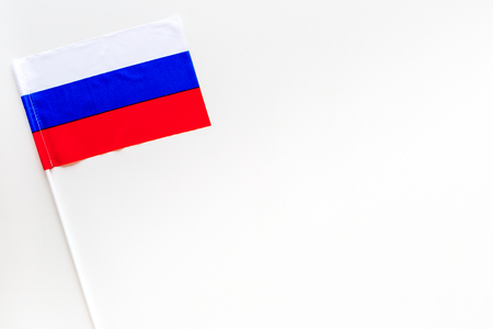 Russian flag concept. Small flag on white background top view.