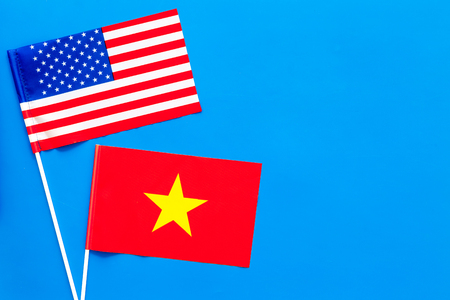 American and Vietnamese flags top view copy space