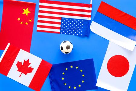 Football championship. Flags, ball top view copy space Reklamní fotografie - 103681560