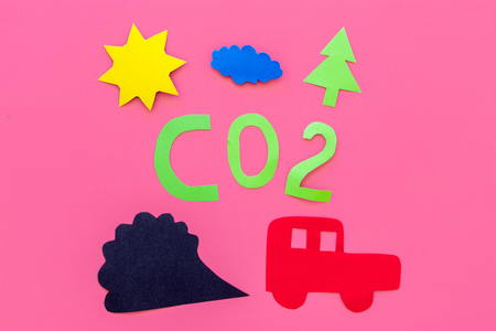 Cars emitting carbon dioxide. Pollution concept. harm the environment. Car and smoke cutout on pink background top view. Imagens