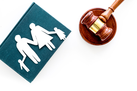 Family law, family right concept. Child-custody concept. Family with children cutout near court gavel on white background top view. Stockfoto - 103681720