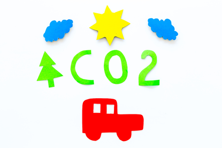 Car pollutes the environment by carbon dioxide. Car, environment and CO2 cutout on white background top view copy space Stock Photo