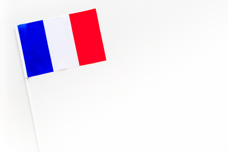 French flag concept. small flag on white background top view copy space 스톡 콘텐츠