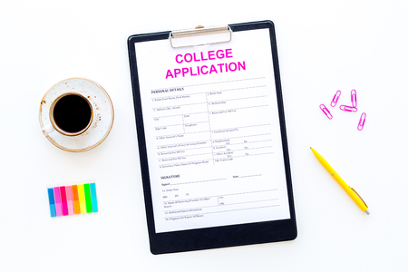 Higher education. College application form ready to fill near coffee cup and stationery on white background top view