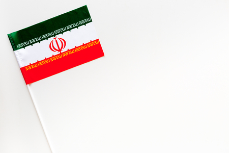 Iranian flag concept. small flag on white background top view copy space