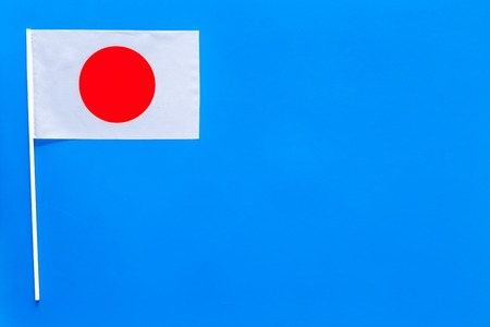 Japanese flag concept. small flag on blue background top view copy space Imagens