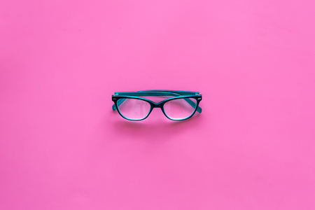One glasses with transparent lenses on pink background top view copy space Stock Photo