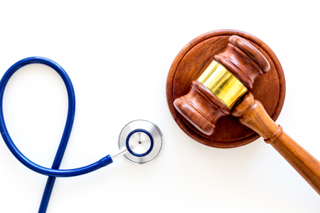 Medical law, health law. Gavel and stethoscope on white backgound top view copy space