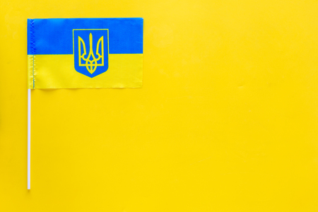Ukrainian flag concept. small flag on yellow background top view copy space 写真素材 - 103862871