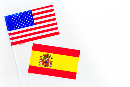 USA-Spain relations. Country cooperation. American and Spanish flags on white background top view copy space 스톡 콘텐츠