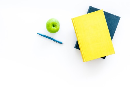 Educational literature. School textbook, book, tutorial and apple on white background top view. Stock Photo