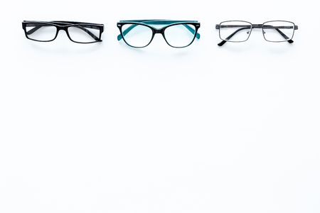 Glasses concept. Set of glasses with different eyeglass frame and transparent lenses on white background top view. Reklamní fotografie
