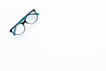 Glasses with transparent lenses on white background top view. Stock Photo - 103894833