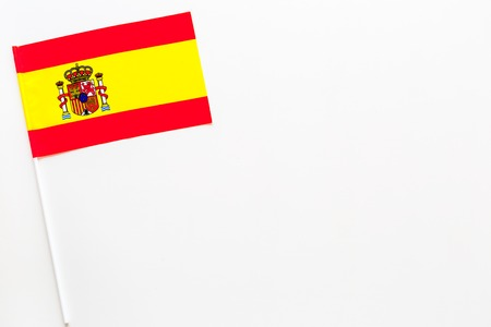 Spanish flag concept. Small flag top view 스톡 콘텐츠