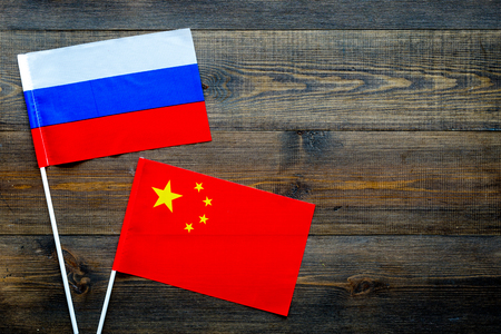 Russian and Chinese flags top view copy space Stock Photo