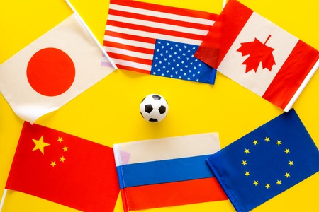 Football championship. Flags, ball top view copy space