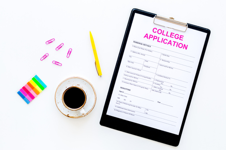 Higher education. College application form ready to fill near coffee cup and stationery on white background top view.