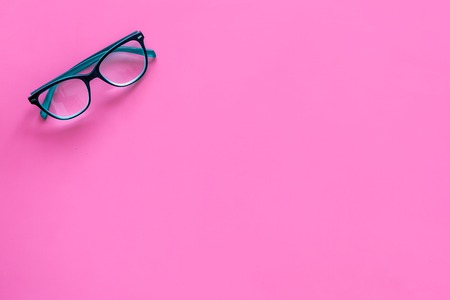 One glasses with transparent lenses on pink background top view. Stock Photo