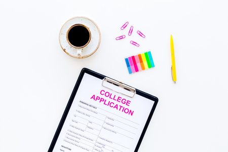 Apply college. Empty college application form near coffee cup and stationery on white background top view. 스톡 콘텐츠