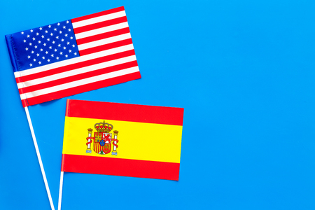 American and Spanish flags top view copy space