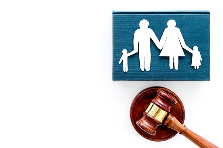 Family law, family right concept. Child-custody concept. Family with children cutout near court gavel on white background top view copy space Stockfoto - 104215133