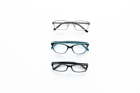 Glasses concept. Set of glasses with different eyeglass frame and transparent lenses on white background top view copy space pattern Stock Photo