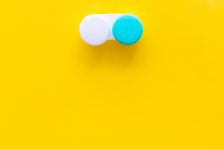 Contact lenses in container on yellow background top view copy space Stock Photo