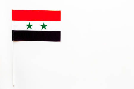 Syrian flag concept. small flag on white background top view copy space