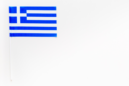 Greece flag concept. small flag on white background top view copy space